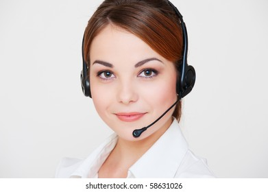 portrait of friendly telephone operator over grey background