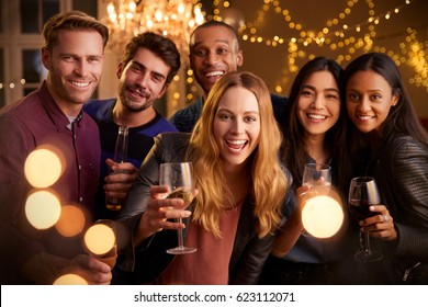 Portrait Of Friends With Drinks Enjoying House Party