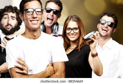 portrait of friends group smiling and joking against a abstract background