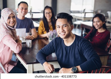 portrait of friends having fun together in a cafe. looking at camera