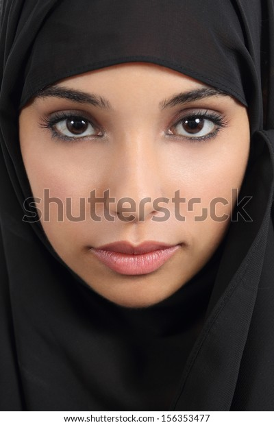 Portrait of a front view of a beautiful arab woman face with a black scarf