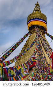 Portrait front view of Boudhanath Stupa and prayer flags. Kathmandu, Nepal. Boudha Stupa is one of the largest stupas in the world.