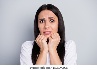 Portrait of frustrated anxious girl hear horrible corona virus novelty disease feel fear touch fists face chin wear good look outfit isolated over gray color background