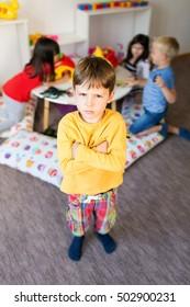 Portrait of frustrated boy in kindergarten
