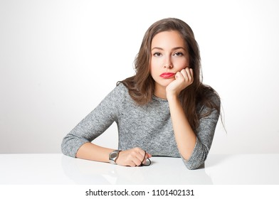 Portrait of frustrated tired looking brunette woman.