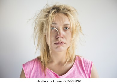 Portrait of frustrated woman suffering from cold against gray background