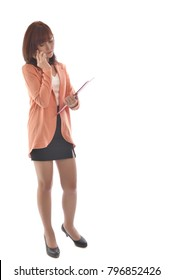 Portrait full body of young businesswoman in suit holding red file and use smartphone isolated on white background. Asian woman on white background. Free from copy space.