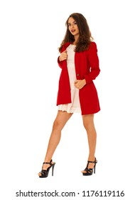 Portrait in full growth of a beautiful young brunette woman in red autumn coat, isolated on white background