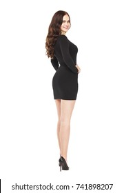 936b7947b0 Portrait in full growth of a beautiful young brunette woman in sexy black  dress