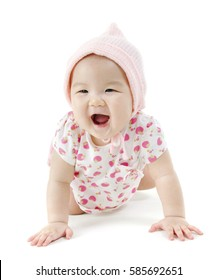 Portrait of full length beautiful Asian baby girl in pink clothes crawling on floor, isolated on white background.
