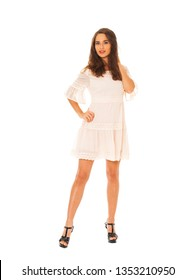 Portrait of a full length young beautiful brunette woman in white dress, isolated on a white background