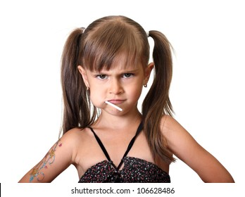 Portrait of funny angry child girl with candy isolated on white