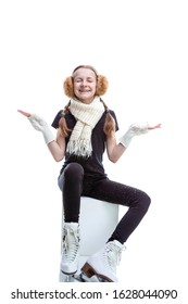 Portrait of Funny Caucasian Teenage Girl Posing in  Iceskates With Snowflakes Falling Against White. Vertical Image