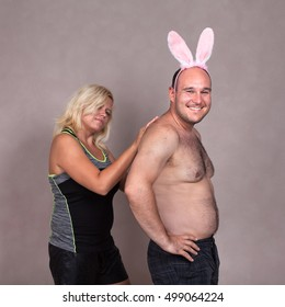 Portrait of funny couple with bunny ears.