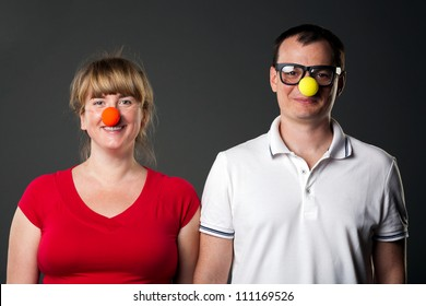Portrait of funny couple with funny noses