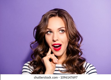 Portrait of funny dreamy girl with vivid bright pomade find idea solution decision  looking up with open mouth guessing answer isolated on violet background