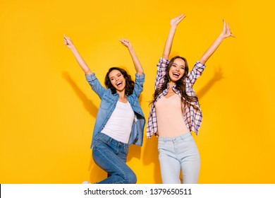 Portrait of funny funky youth millennial raise arms rejoice funny funky  free time weekends holidays glad content scream shout dressed modern denim plaid outfit isolated yellow background