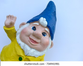 Portrait of a funny garden dwarf in front of  white background