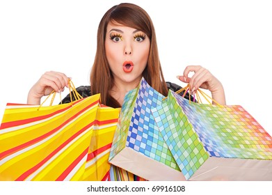 portrait of funny girl with shopping bags over white background