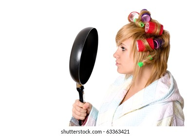 portrait of funny housewife with curlers and pan isolated on white background