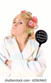 portrait of funny housewife with curlers and skimmer isolated on white background