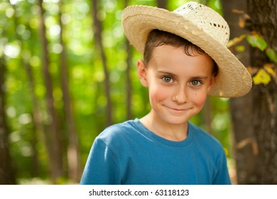 Portrait of a funny kid with straw hat outdoor