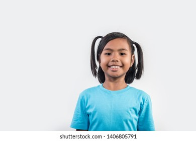 Portrait of Funny little girl acting in studio shot