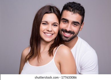 Portrait of a funny love couple hugging each other