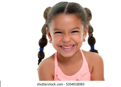 Portrait of a funny multiracial small girl smiling  - Isolated on a white background
