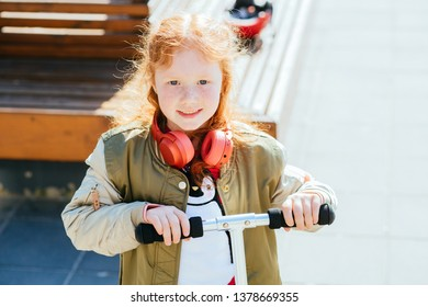 portrait of funny red-haired girl with freckles, children's emotions outdoor? sunny spring day.