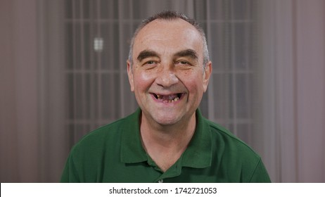 Portrait of Funny smile without teeth of happy old man.