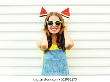 Portrait funny smiling woman with a two slice of watermelon ice cream having fun