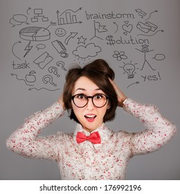 Portrait of Funny Surprised Hipster Girl with Many Ideas. Brainstorm Workflow Concept.