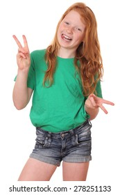 Portrait of a funny teenage girl showing victory sign on white background