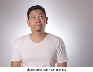 Portrait of funny young asian man bored with eyes glance up, Saturated, Bored guy, Tired man
