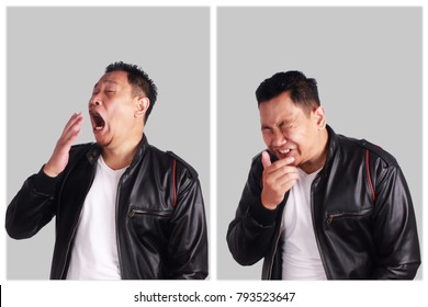 Portrait of funny young Asian man wearing black leather jacket sneezing, over grewy background