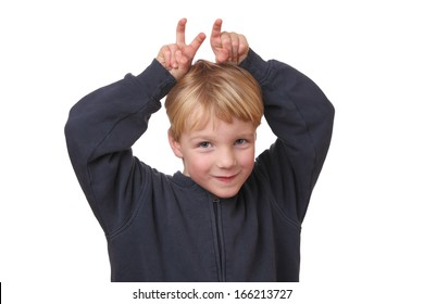 Portrait of a funny young boy with hands on his head on white background