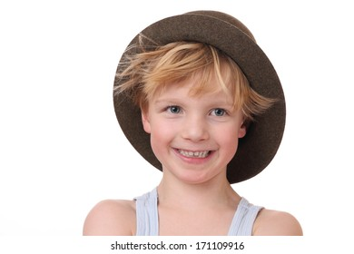 Portrait of a funny young boy with hat on white background