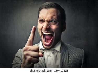 portrait of furious man screaming