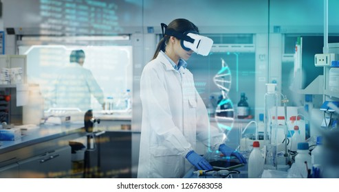 Portrait of futuristic researcher using the augmented reality vr glasses with hologram graphics for viewing results of research in laboratory. Shot in 8K. Concept of futuristic medicine and science