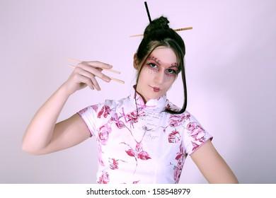 portrait of geisha with  chopsticks