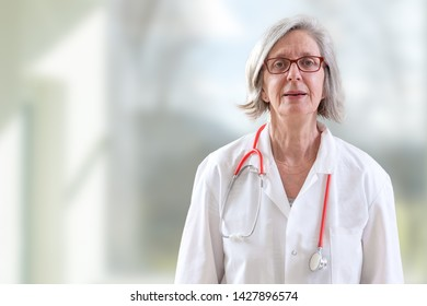 Portrait of a general hospital doctor against white background.