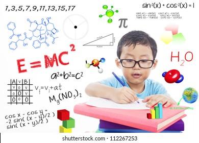 Portrait of genius boy trying to solve formula