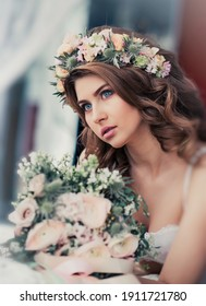 Portrait of a gentle bride with flowers. Beautiful tender bridal morning