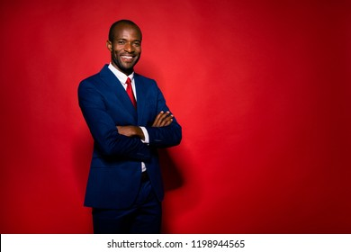 Portrait of gentle chic classy man stand isolated on red bright background with copy space for text crossed folded hands on chest look at camera with pretty charming smile