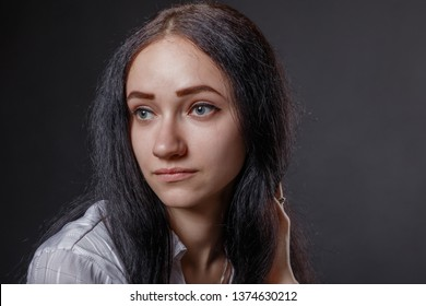 Portrait of a gentle pensive girl