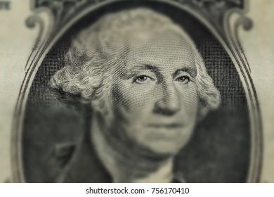 Portrait of George Washington on 1 dollar bill, close-up.