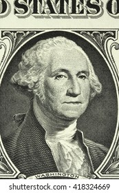 a portrait of George Washington on the banknote in one American dollar close-up