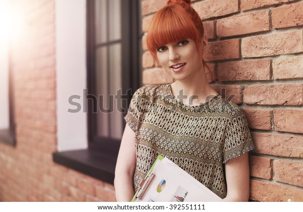 Portrait of ginger woman at the office