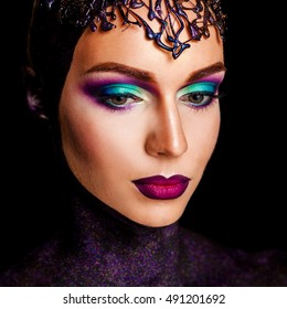 portrait of a girl with art make-up. art photo of a beautiful woman. makeup concept art